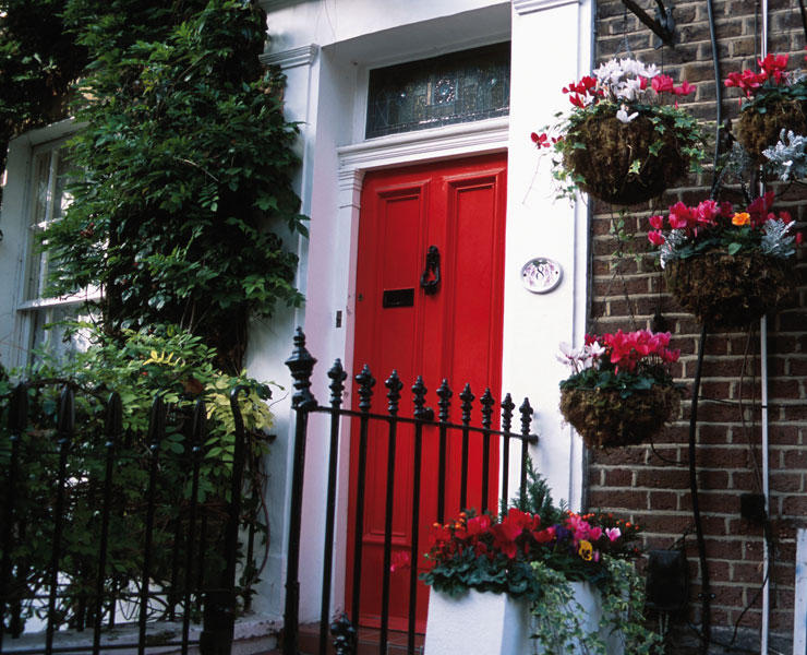 House with Red Front Door Hanging Baskets